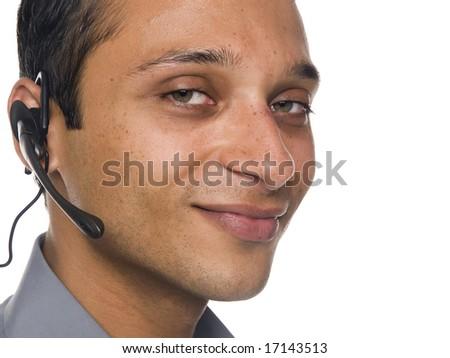 Isolated studio head shot of a smiling customer service representative. - stock photo