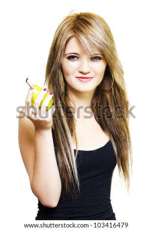 Isolated studio photo of a healthy young woman holding up a fresh ripe pear in a healthy eating, dieting and nutrition concept on white background - stock photo