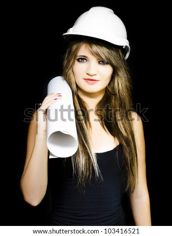 Isolated studio photo of a pretty and young female structural engineer holding construction design blueprints during a site inspection on black background - stock photo