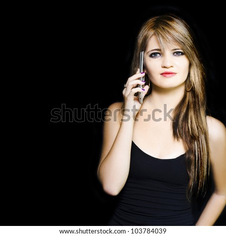 Isolated studio portrait of a attractive young business woman using a mobile phone during a office teleconference call, image with copyspace and black background - stock photo