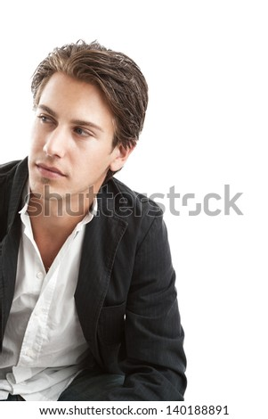 Isolated studio portrait of a handsome thoughtful young man looking off to the left of the frame with copy space - stock photo
