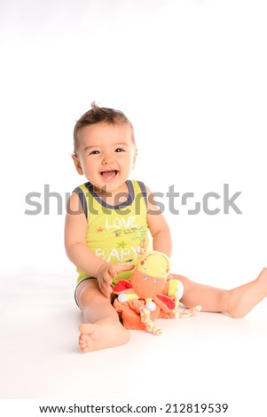isolated studio portrait of lovely toddler baby boy playing and laughing - stock photo