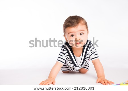 isolated studio portrait on white background of lovely toddler baby boy playing and laughing - stock photo