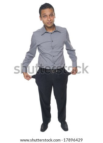 Isolated studio shot of a bankrupt businessman holding his empty pockets. - stock photo