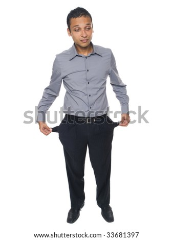 Isolated studio shot of a broke businessman holding out his empty pockets. - stock photo