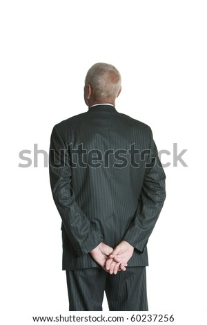 Isolated studio shot of a business man from behind over white background