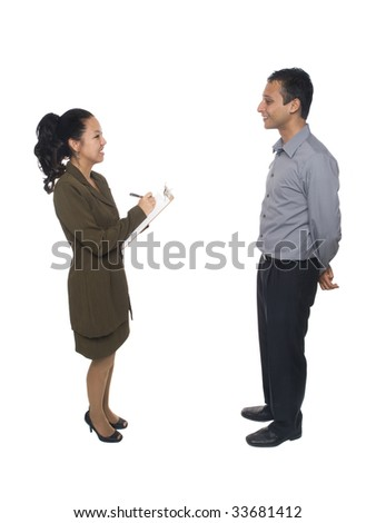 Isolated studio shot of a businessman and businesswoman filling out information on a clipboard during an interview - stock photo
