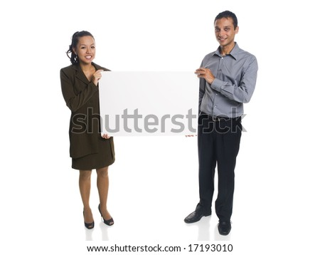 Isolated studio shot of a businessman and businesswoman holding a blank sign. - stock photo