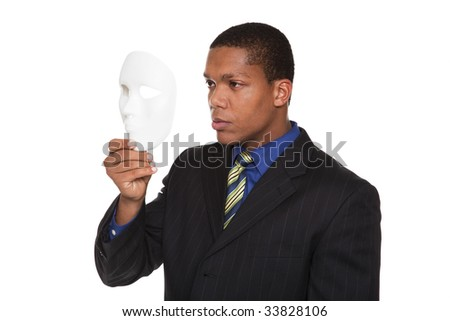 Isolated studio shot of a businessman holding a blank costume mask up to his face.