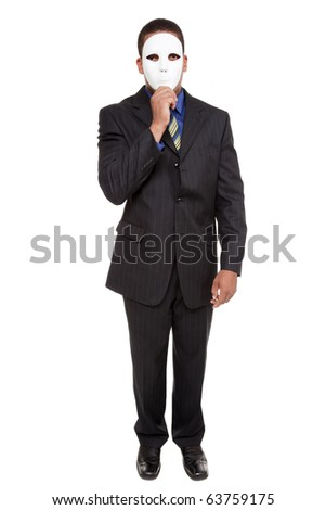 Isolated studio shot of a businessman holding a blank costume mask up to his face and looking at the camera. - stock photo