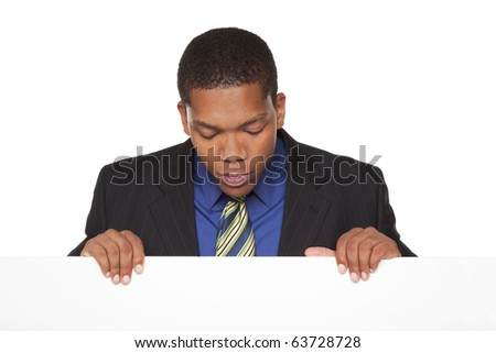 Isolated studio shot of a businessman holding a blank sign - stock photo