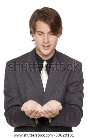Isolated studio shot of a businessman holding out his hands, cupped as if he were holding something delicate. - stock photo