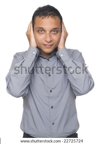 Isolated studio shot of a businessman in the Hear No Evil pose.