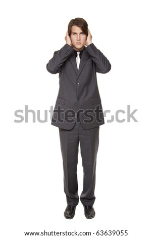 Isolated studio shot of a businessman in the Hear No Evil pose. - stock photo