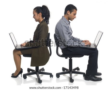 Isolated studio shot of a businessman sitting using a laptop computer while sitting in a chair. - stock photo