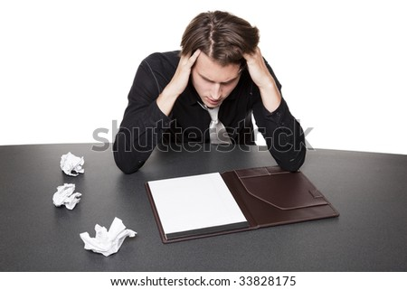 Isolated studio shot of a businessman suffering from writers block trying again after several failed starts. - stock photo