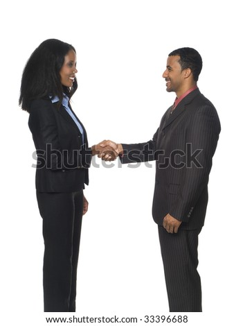 Isolated studio shot of a businesswoman and businessman happily shaking hands with each other in a warm greeting.