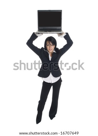 Isolated studio shot of a businesswoman holding a laptop computer over her head. - stock photo