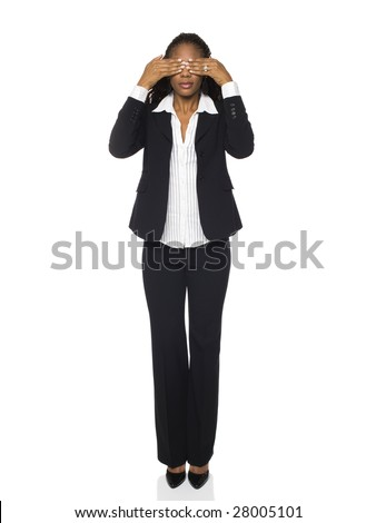 Isolated studio shot of a businesswoman in the See No Evil pose. - stock photo
