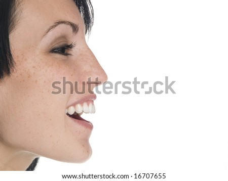 Isolated studio shot of a businesswoman laughing out loud from the side.