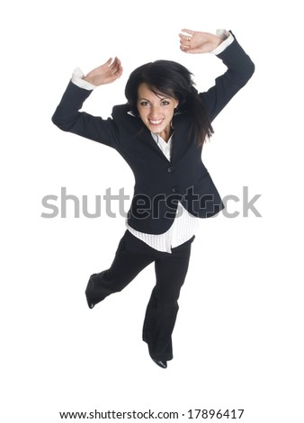 Isolated studio shot of a businesswoman leaping for joy.  Small motion blur on hand and foot.