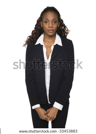 Isolated studio shot of a businesswoman looking at the camera with a neutral smile. - stock photo