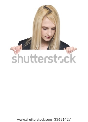 Isolated studio shot of a businesswoman looking down at a blank sign