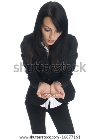Isolated studio shot of a businesswoman looking with amazement at her cupped hands.