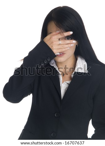 Isolated studio shot of a businesswoman peeking through the hand covering her eyes. - stock photo