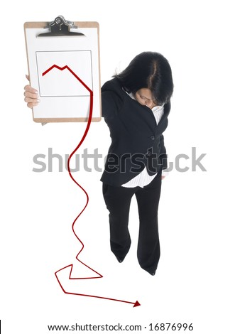 Isolated studio shot of a businesswoman presenting a clipboard with a downward trending graph that has fallen off the page onto the floor.