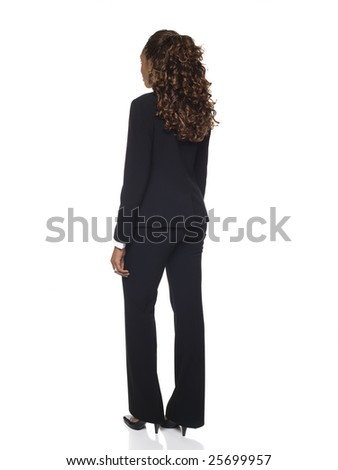 Isolated studio shot of a businesswoman rotating through 360 degrees. - stock photo