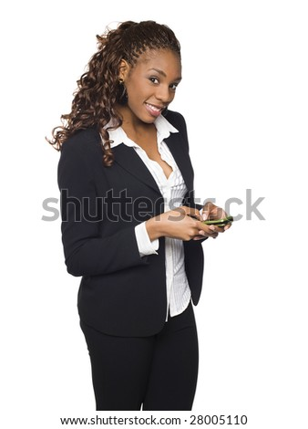 Isolated studio shot of a businesswoman sending text messages from her cell phone. - stock photo