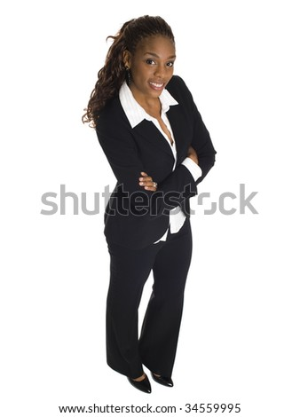 Isolated studio shot of a businesswoman smiling up at the camera. - stock photo