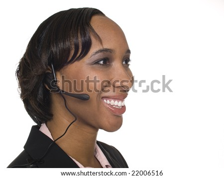 Isolated studio shot of a businesswoman talking on a customer service telephone headset. - stock photo