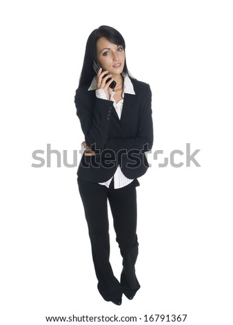Isolated studio shot of a businesswoman talking on her cell phone.