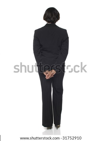 Isolated studio shot of a businesswoman viewed from behind. - stock photo