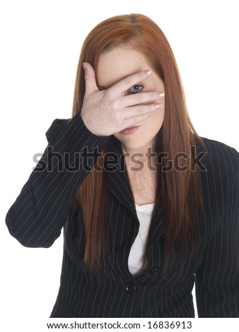 Isolated studio shot of a businesswoman who is peeking even though she just can't look. - stock photo
