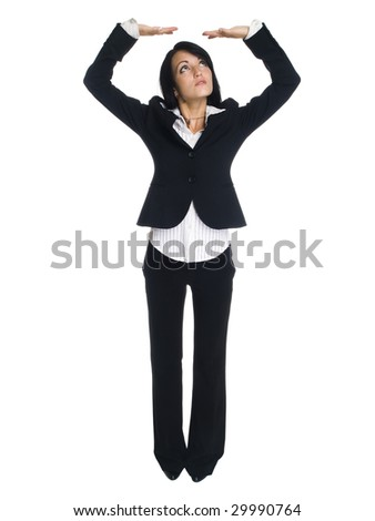 Isolated studio shot of a businesswoman with her arms raised overhead as if she were holding something up. - stock photo