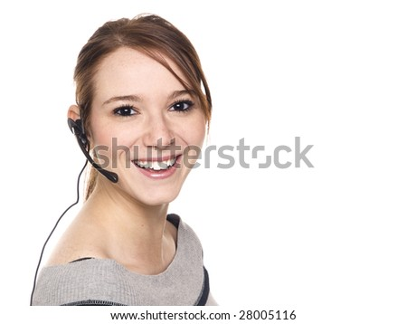 Isolated studio shot of a casually dressed young adult woman wearing a telephone headset and looking at the camera. - stock photo