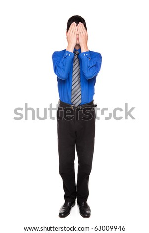 Isolated studio shot of a Caucasian businessman in the See No Evil pose.