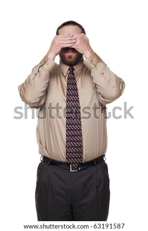 Isolated studio shot of a Caucasian businessman in the See No Evil pose. - stock photo