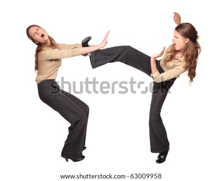 Isolated studio shot of a Caucasian businesswoman fighting with herself.