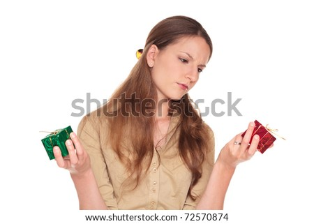Isolated studio shot of a Caucasian businesswoman making a difficult choice between a red present and a green present.