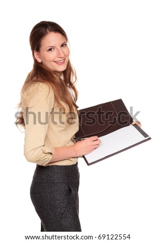 Isolated studio shot of a Caucasian businesswoman smiling at the camera while writing on a business notepad.