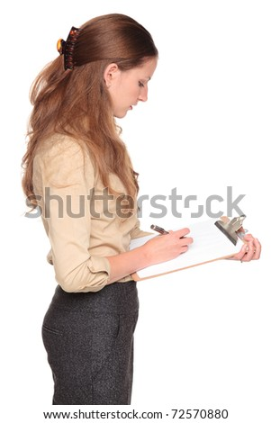 Isolated studio shot of a Caucasian businesswoman taking notes on a clipboard