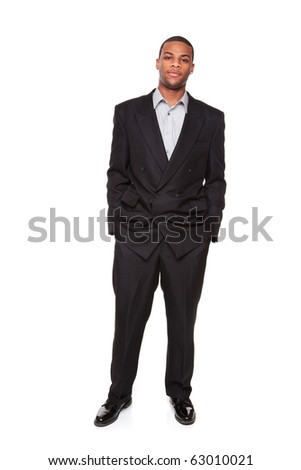 Isolated studio shot of a Confident African American businessman standing and looking directly at the camera. - stock photo