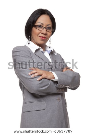 Isolated studio shot of a confident Latina businesswoman looking directly at the camera with a small smile. - stock photo