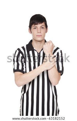 Isolated studio shot of a handsome young man in a referee uniform making holding penalty sign. - stock photo
