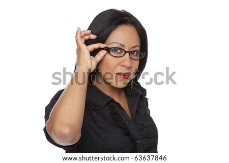 Isolated studio shot of a Latina businesswoman adjusting her glasses. - stock photo