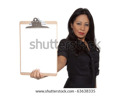 Isolated studio shot of a Latina businesswoman holding out a blank clipboard at arms length. - stock photo